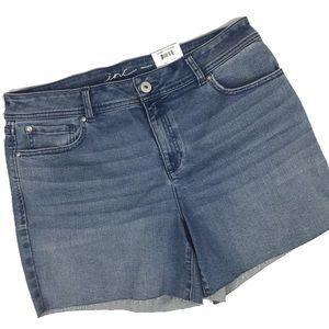 Medium Wash Mid Rise Frayed Hem Jean Shorts